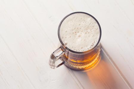 Photo pour Mug of beer on wooden background  - image libre de droit