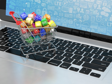 Photo for shopping cart with application software icons on laptop - Royalty Free Image