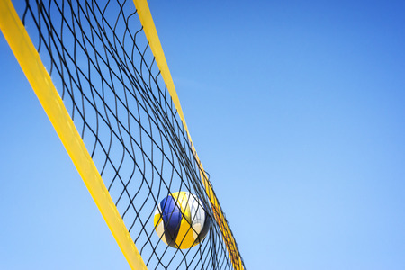 Beach volleyball caught in the net.