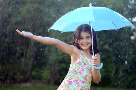 young girl enjoying the rain