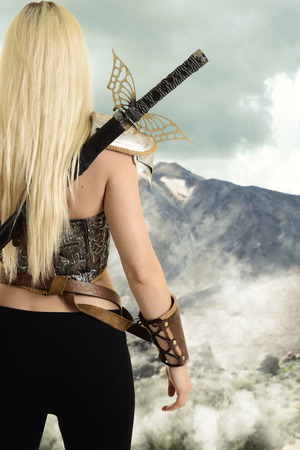 Photo for back of female warrior looking at mountain - Royalty Free Image