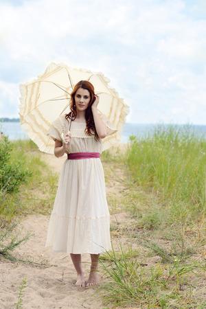 vintage redhead woman on beach trail