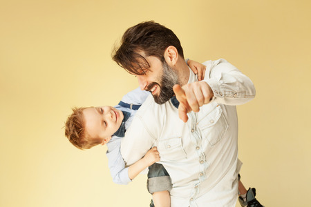 Photo for Happy little boy enjoying with riding on father's back - Royalty Free Image