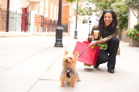 woman with dog and shopping bags