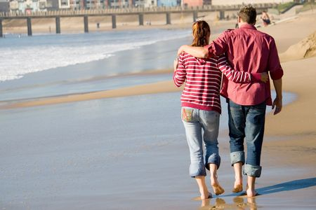 Photo for couple walkingon shore - Royalty Free Image