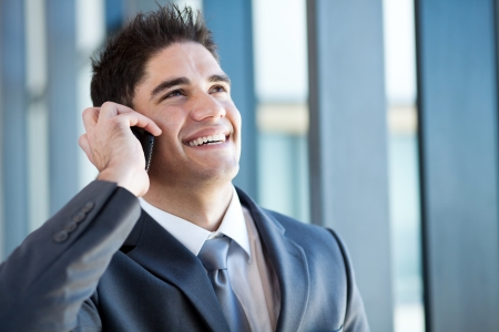 happy young businessman talking on the mobile phone