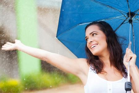 attractive young woman having fun in the rain