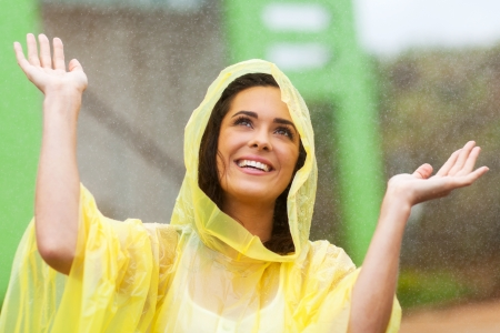 happy young woman playing in the rain