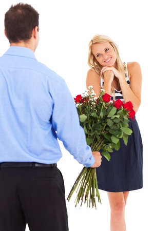 happy woman receiving roses from a young man