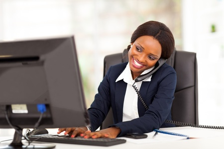 beautiful young african american businesswoman working in office