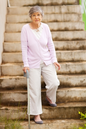 Photo for lonely senior woman standing by stairway - Royalty Free Image
