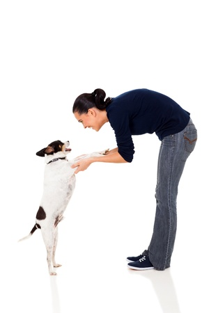 pretty woman training a pet dog isolated on white background