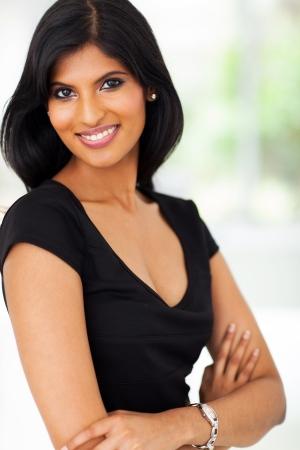 portrait of young pretty indian businesswoman in office
