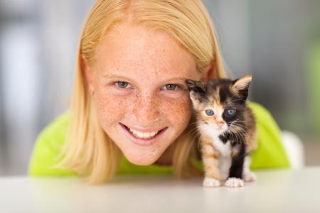 beautiful teen girl with her little kitten pet