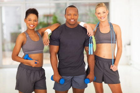 group of diversity people holding various gym equipment after exercise