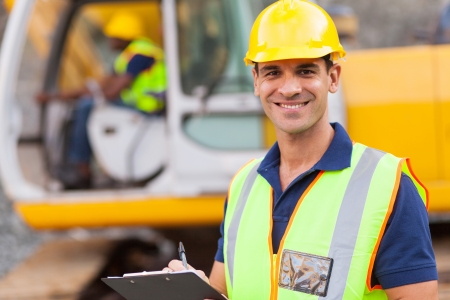Photo pour handsome road construction supervisor with clipboard - image libre de droit
