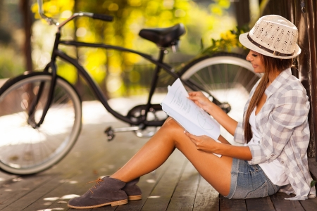 beautiful young woman studying at the park