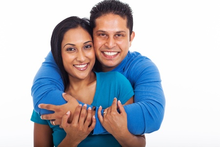 portrait of loving couple embracing isolated on white background