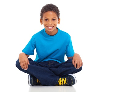 Photo for cute african american boy sitting on white background - Royalty Free Image