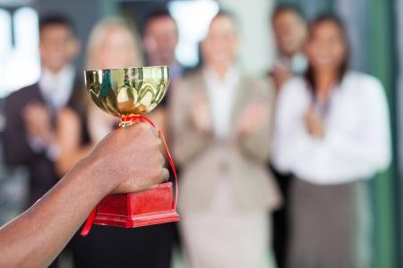 Photo pour business team winning a trophy - image libre de droit