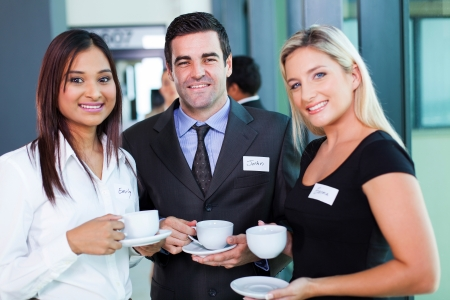 Foto de group of business people having coffee during business conference break - Imagen libre de derechos