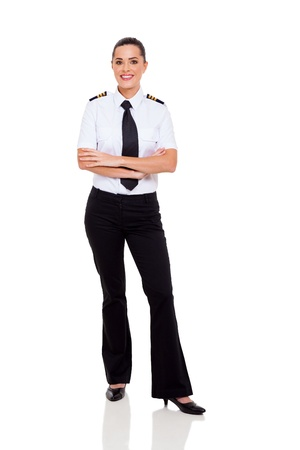 Photo pour beautiful female young airline co-pilot with arms crossed isolated on white - image libre de droit