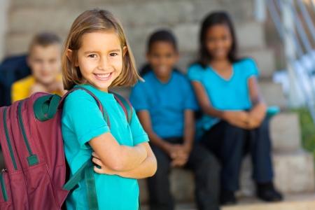 Foto de portrait of pretty preschool girl with backpack outdoors - Imagen libre de derechos