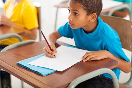 Foto de adorable african american primary school student studying Chinese in classroom - Imagen libre de derechos