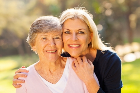 Photo for smiling senior woman and middle aged daughter outdoors closeup portrait - Royalty Free Image