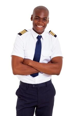 Photo pour handsome african pilot in uniform isolated on white - image libre de droit
