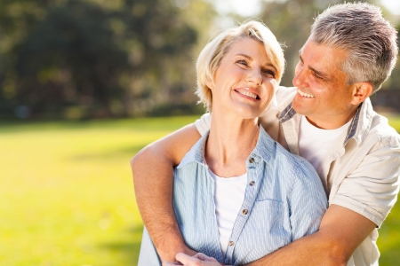 Photo for cute middle aged couple embracing outdoors  - Royalty Free Image