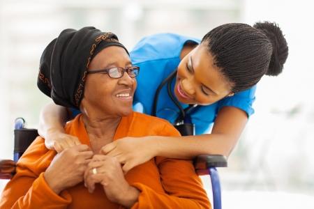 Foto de happy senior patient with friendly female nurse - Imagen libre de derechos