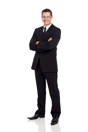 Photo for friendly business man in a suit with arms folded isolated on white - Royalty Free Image