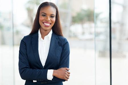 Foto de attractive african american corporate worker standing in office - Imagen libre de derechos
