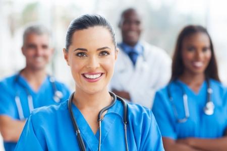Foto de beautiful medical nurse and colleagues in hospital - Imagen libre de derechos