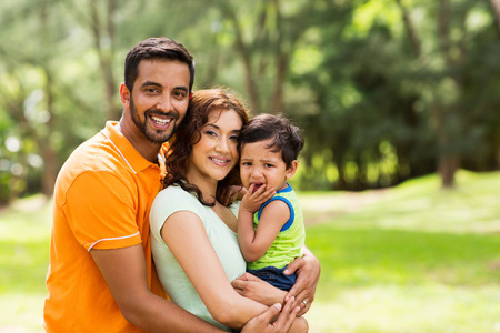 Photo for beautiful young indian family outdoors looking at the camera - Royalty Free Image