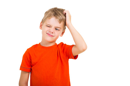 Photo pour young boy scratching his head isolated on white - image libre de droit