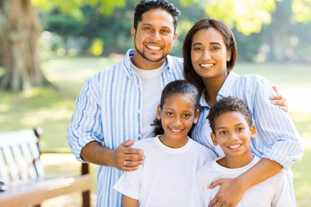 Photo pour happy indian family standing at the park - image libre de droit