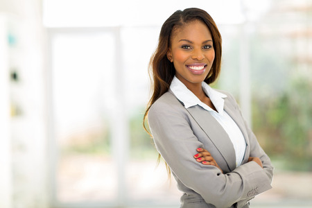 Photo pour portrait of young pretty african american businesswoman in office - image libre de droit