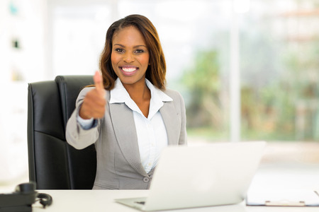 Photo pour cheerful young african businesswoman giving thumb up - image libre de droit