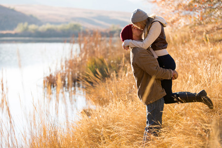 Photo for lovely young couple kissing outdoors in autumn - Royalty Free Image