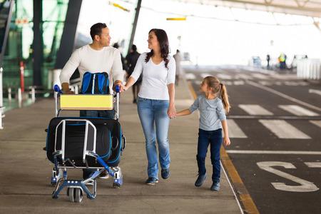 Photo pour happy traveling family with suitcases at airport - image libre de droit