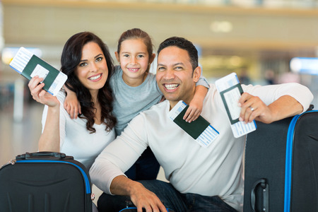 Photo for happy family holding boarding pass and passport at airport - Royalty Free Image