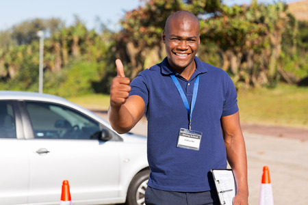 Photo for portrait of handsome african driving school instructor giving thumb up - Royalty Free Image