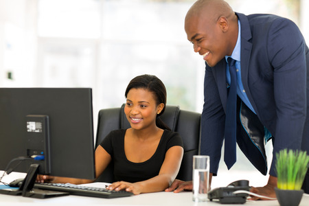 Photo pour professional african businesspeople working on computer - image libre de droit