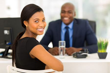 Foto de attractive african office worker looking back - Imagen libre de derechos