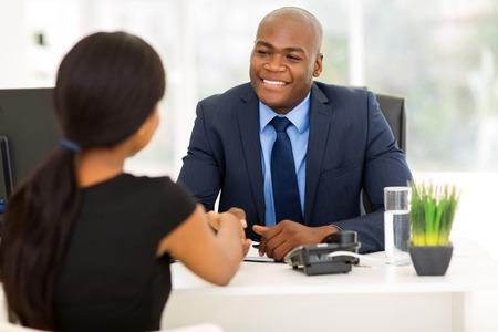 Foto de successful african american businessman handshaking with client in office - Imagen libre de derechos