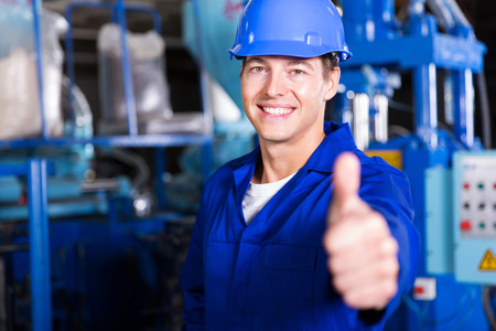 Photo for cheerful worker thumb up in factory - Royalty Free Image