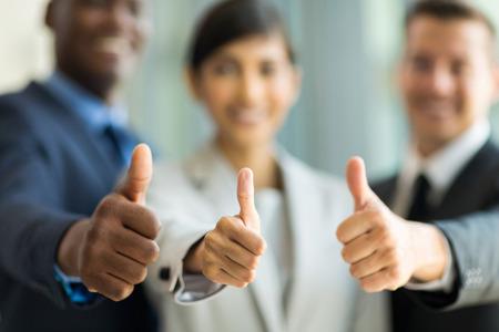 Foto de close up of multiracial business team giving thumbs up - Imagen libre de derechos