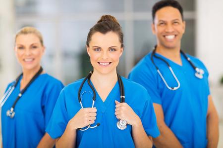 Foto de attractive medical nurse and colleagues in hospital - Imagen libre de derechos
